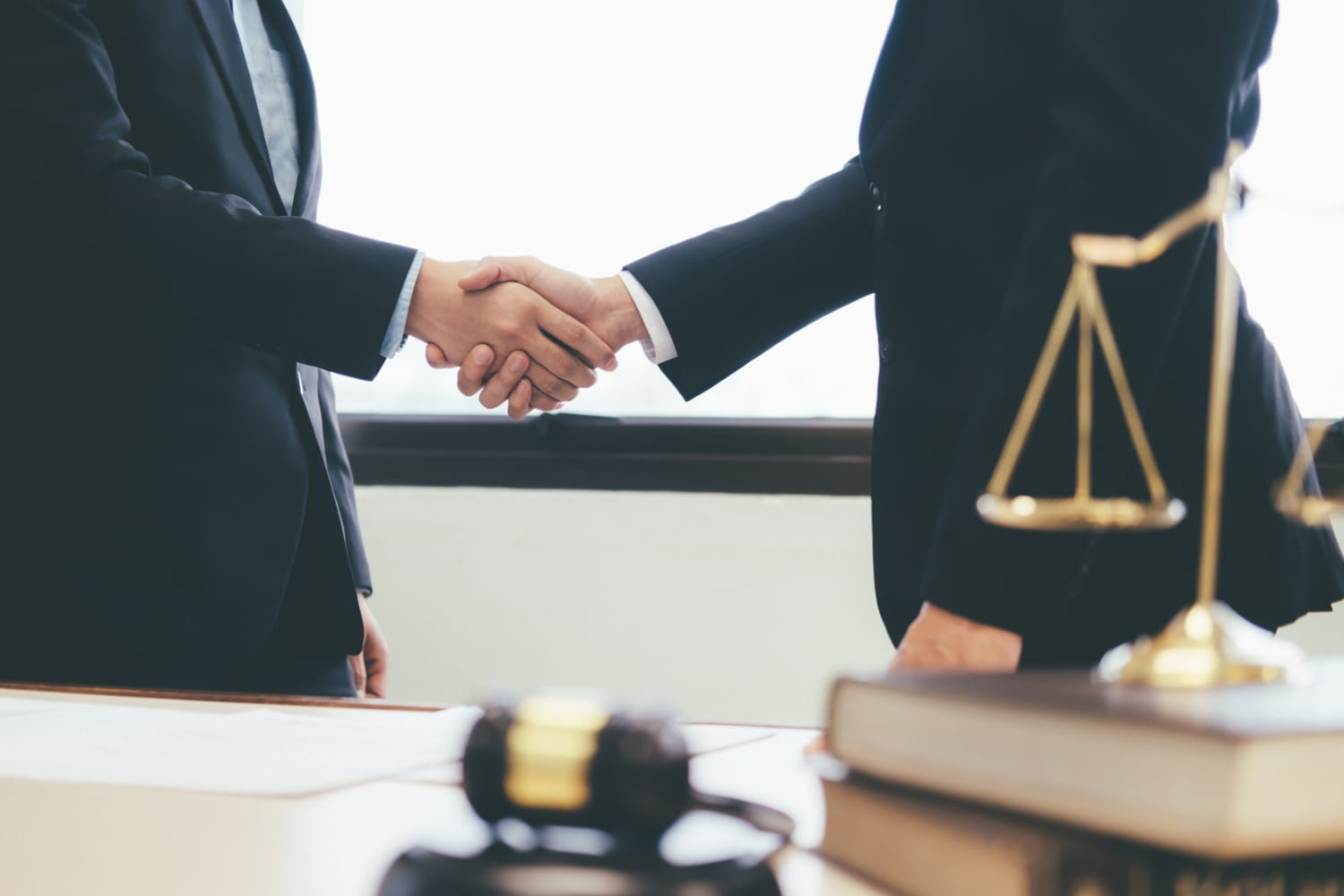 Lawyer and attorney having team meeting at law firm